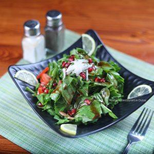 Rocca Salad with Pomegranates Sauce - Aljalboot Restaurant in Dubai