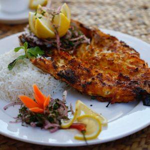Grilled Sea bass Fish - Aljalboot Restaurant in Dubai